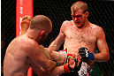TORONTO, CANADA - SEPTEMBER 22: (R-L) Evan Dunham kicks T.J. Grant during their lightweight bout at UFC 152 inside Air Canada Centre on September 22, 2012 in Toronto, Ontario, Canada. (Photo by Al Bello/Zuffa LLC/Zuffa LLC via Getty Images)