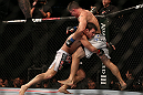 TORONTO, CANADA - SEPTEMBER 22: (L-R) Michael Bisping takes down Brian Stann during their middleweight bout at UFC 152 inside Air Canada Centre on September 22, 2012 in Toronto, Ontario, Canada. (Photo by Josh Hedges/Zuffa LLC/Zuffa LLC via Getty Images)