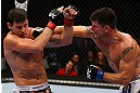 TORONTO, CANADA - SEPTEMBER 22: (R-L) Brian Stann punches Michael Bisping during their middleweight bout at UFC 152 inside Air Canada Centre on September 22, 2012 in Toronto, Ontario, Canada. (Photo by Al Bello/Zuffa LLC/Zuffa LLC via Getty Images)
