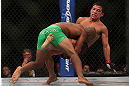 TORONTO, CANADA - SEPTEMBER 22:    (L-R) Demetrious Johnson takes down Joseph Benavidez during their flyweight championship bout at UFC 152 inside Air Canada Centre on September 22, 2012 in Toronto, Ontario, Canada.  (Photo by Josh Hedges/Zuffa LLC/Zuffa LLC via Getty Images)