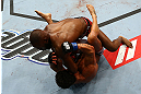 Jon Jones (top) delivers an elbow against Vitor Belfort during their light heavyweight championship bout at UFC 152 inside Air Canada Centre on September 22, 2012 in Toronto, Ontario, Canada. (Photo by Al Bello/Zuffa LLC/Zuffa LLC via Getty Images)
