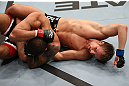 NOTTINGHAM, ENGLAND - SEPTEMBER 29:  (R-L) Gunnar Nelson punches DaMarques Johnson during their catchweight fight at the UFC on Fuel TV event at Capital FM Arena on September 29, 2012 in Nottingham, England.  (Photo by Josh Hedges/Zuffa LLC/Zuffa LLC via Getty Images)