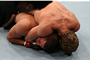 NOTTINGHAM, ENGLAND - SEPTEMBER 29:  (R-L) Gunnar Nelson secures a rear choke submission against DaMarques Johnson during their catchweight fight at the UFC on Fuel TV event at Capital FM Arena on September 29, 2012 in Nottingham, England.  (Photo by Josh Hedges/Zuffa LLC/Zuffa LLC via Getty Images)