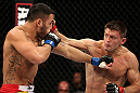 NOTTINGHAM, ENGLAND - SEPTEMBER 29:  (R-L) Tom Watson punches Brad Tavares during their middleweight fight at the UFC on Fuel TV event at Capital FM Arena on September 29, 2012 in Nottingham, England.  (Photo by Josh Hedges/Zuffa LLC/Zuffa LLC via Getty Images)