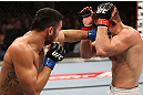 NOTTINGHAM, ENGLAND - SEPTEMBER 29:  (L-R) Brad Tavares punches Tom Watson during their middleweight fight at the UFC on Fuel TV event at Capital FM Arena on September 29, 2012 in Nottingham, England.  (Photo by Josh Hedges/Zuffa LLC/Zuffa LLC via Getty Images)