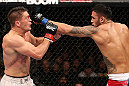 NOTTINGHAM, ENGLAND - SEPTEMBER 29:  (R-L) Brad Tavares punches Tom Watson during their middleweight fight at the UFC on Fuel TV event at Capital FM Arena on September 29, 2012 in Nottingham, England.  (Photo by Josh Hedges/Zuffa LLC/Zuffa LLC via Getty Images)