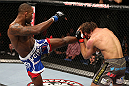 NOTTINGHAM, ENGLAND - SEPTEMBER 29:  (L-R) Jimi Manuwa kicks Kyle Kingsbury during their light heavyweight fight at the UFC on Fuel TV event at Capital FM Arena on September 29, 2012 in Nottingham, England.  (Photo by Josh Hedges/Zuffa LLC/Zuffa LLC via Getty Images)