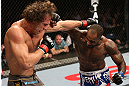 NOTTINGHAM, ENGLAND - SEPTEMBER 29:  (R-L) Jimi Manuwa punches Kyle Kingsbury during their light heavyweight fight at the UFC on Fuel TV event at Capital FM Arena on September 29, 2012 in Nottingham, England.  (Photo by Josh Hedges/Zuffa LLC/Zuffa LLC via Getty Images)