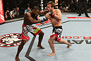 NOTTINGHAM, ENGLAND - SEPTEMBER 29:  (R-L) Brad Pickett knocks out Yves Jabouin with an uppercut during their bantamweight fight at the UFC on Fuel TV event at Capital FM Arena on September 29, 2012 in Nottingham, England.  (Photo by Josh Hedges/Zuffa LLC/Zuffa LLC via Getty Images)