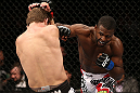 NOTTINGHAM, ENGLAND - SEPTEMBER 29:  (R-L) Yves Jabouin punches Brad Pickett during their bantamweight fight at the UFC on Fuel TV event at Capital FM Arena on September 29, 2012 in Nottingham, England.  (Photo by Josh Hedges/Zuffa LLC/Zuffa LLC via Getty Images)