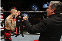 NOTTINGHAM, ENGLAND - SEPTEMBER 29:  Dan Hardy (L) is introduced by Bruce Buffer before his welterweight fight against Amir Sadollah at the UFC on Fuel TV event at Capital FM Arena on September 29, 2012 in Nottingham, England.  (Photo by Josh Hedges/Zuffa LLC/Zuffa LLC via Getty Images)