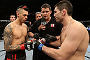 NOTTINGHAM, ENGLAND - SEPTEMBER 29:  Opponents Dan Hardy (L) and Amir Sadollah (R) receive final instructions from referee Mark Goddard before their welterweight fight at the UFC on Fuel TV event at Capital FM Arena on September 29, 2012 in Nottingham, England.  (Photo by Josh Hedges/Zuffa LLC/Zuffa LLC via Getty Images)