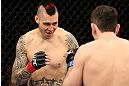 NOTTINGHAM, ENGLAND - SEPTEMBER 29:  (L-R) Dan Hardy squares off with Amir Sadollah during their welterweight fight at the UFC on Fuel TV event at Capital FM Arena on September 29, 2012 in Nottingham, England.  (Photo by Josh Hedges/Zuffa LLC/Zuffa LLC via Getty Images)