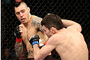 NOTTINGHAM, ENGLAND - SEPTEMBER 29:  (L-R) Dan Hardy punches Amir Sadollah during their welterweight fight at the UFC on Fuel TV event at Capital FM Arena on September 29, 2012 in Nottingham, England.  (Photo by Josh Hedges/Zuffa LLC/Zuffa LLC via Getty Images)