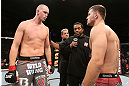 NOTTINGHAM, ENGLAND - SEPTEMBER 29:  Opponents Strefan Struve (L) and Stipe Miocic (R) receive final instructions from referee Herb Dean before their heavyweight fight at the UFC on Fuel TV event at Capital FM Arena on September 29, 2012 in Nottingham, England.  (Photo by Josh Hedges/Zuffa LLC/Zuffa LLC via Getty Images)