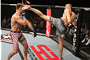 NOTTINGHAM, ENGLAND - SEPTEMBER 29:  (R-L) Strefan Struve kicks Stipe Miocic during their heavyweight fight at the UFC on Fuel TV event at Capital FM Arena on September 29, 2012 in Nottingham, England.  (Photo by Josh Hedges/Zuffa LLC/Zuffa LLC via Getty Images)