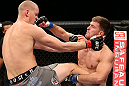NOTTINGHAM, ENGLAND - SEPTEMBER 29:  (R-L) Stipe Miocic punches Strefan Struve during their heavyweight fight at the UFC on Fuel TV event at Capital FM Arena on September 29, 2012 in Nottingham, England.  (Photo by Josh Hedges/Zuffa LLC/Zuffa LLC via Getty Images)