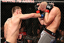 NOTTINGHAM, ENGLAND - SEPTEMBER 29:  (L-R) Stipe Miocic punches Strefan Struve during their heavyweight fight at the UFC on Fuel TV event at Capital FM Arena on September 29, 2012 in Nottingham, England.  (Photo by Josh Hedges/Zuffa LLC/Zuffa LLC via Getty Images)