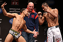 MINNEAPOLIS, MN - OCTOBER 04:  (L-R) Opponents John Dodson and Jussier Formiga face off during the UFC on FX weigh in at Pantages Theater on October 4, 2012 in Minneapolis, Minnesota.  (Photo by Josh Hedges/Zuffa LLC/Zuffa LLC via Getty Images)