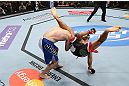 MINNEAPOLIS, MN - OCTOBER 05:  (R-L) Darren Uyenoyama throws a flying kick against Phil Harris during their flyweight fight at the UFC on FX event at Target Center on October 5, 2012 in Minneapolis, Minnesota.  (Photo by Josh Hedges/Zuffa LLC/Zuffa LLC via Getty Images)