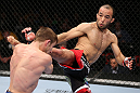 MINNEAPOLIS, MN - OCTOBER 05:  (R-L) Darren Uyenoyama kicks Phil Harris during their flyweight fight at the UFC on FX event at Target Center on October 5, 2012 in Minneapolis, Minnesota.  (Photo by Josh Hedges/Zuffa LLC/Zuffa LLC via Getty Images)