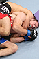 MINNEAPOLIS, MN - OCTOBER 05:  (L-R) Darren Uyenoyama secures a rear choke submission against Phil Harris during their flyweight fight at the UFC on FX event at Target Center on October 5, 2012 in Minneapolis, Minnesota.  (Photo by Josh Hedges/Zuffa LLC/Zuffa LLC via Getty Images)