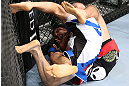 MINNEAPOLIS, MN - OCTOBER 05:  (R-L) Darren Uyenoyama secures a rear choke submission against Phil Harris during their flyweight fight at the UFC on FX event at Target Center on October 5, 2012 in Minneapolis, Minnesota.  (Photo by Josh Hedges/Zuffa LLC/Zuffa LLC via Getty Images)