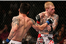 MINNEAPOLIS, MN - OCTOBER 05:  (L-R) Diego Nunes punches Bart Palaszewski during their featherweight fight at the UFC on FX event at Target Center on October 5, 2012 in Minneapolis, Minnesota.  (Photo by Josh Hedges/Zuffa LLC/Zuffa LLC via Getty Images)