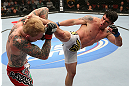 MINNEAPOLIS, MN - OCTOBER 05:  (R-L) Diego Nunes kicks Bart Palaszewski during their featherweight fight at the UFC on FX event at Target Center on October 5, 2012 in Minneapolis, Minnesota.  (Photo by Josh Hedges/Zuffa LLC/Zuffa LLC via Getty Images)