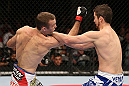 MINNEAPOLIS, MN - OCTOBER 05:  (L-R) Jacob Volkmann punches Shane Roller during their lightweight fight at the UFC on FX event at Target Center on October 5, 2012 in Minneapolis, Minnesota.  (Photo by Josh Hedges/Zuffa LLC/Zuffa LLC via Getty Images)