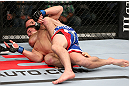 MINNEAPOLIS, MN - OCTOBER 05:  (R-L) Jacob Volkmann secures a rear choke submission against Shane Roller during their lightweight fight at the UFC on FX event at Target Center on October 5, 2012 in Minneapolis, Minnesota.  (Photo by Josh Hedges/Zuffa LLC/Zuffa LLC via Getty Images)