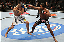 MINNEAPOLIS, MN - OCTOBER 05:  (R-L) Marcus LeVesseur punches Carlo Prater during their lightweight fight at the UFC on FX event at Target Center on October 5, 2012 in Minneapolis, Minnesota.  (Photo by Josh Hedges/Zuffa LLC/Zuffa LLC via Getty Images)