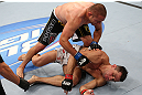 MINNEAPOLIS, MN - OCTOBER 05:  (L-R) Mike Pierce knocks out Aaron Simpson with a series of punches during their welterweight fight at the UFC on FX event at Target Center on October 5, 2012 in Minneapolis, Minnesota.  (Photo by Josh Hedges/Zuffa LLC/Zuffa LLC via Getty Images)