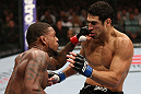 MINNEAPOLIS, MN - OCTOBER 05:  (L-R) Michael Johnson knocks out Danny Castillo with a series of punches during their lightweight fight at the UFC on FX event at Target Center on October 5, 2012 in Minneapolis, Minnesota.  (Photo by Josh Hedges/Zuffa LLC/Zuffa LLC via Getty Images)