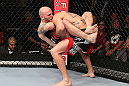 MINNEAPOLIS, MN - OCTOBER 05:  (L-R) Justin Edwards secures a guillotine choke submission to defeat Josh Neer during their welterweight fight at the UFC on FX event at Target Center on October 5, 2012 in Minneapolis, Minnesota.  (Photo by Josh Hedges/Zuffa LLC/Zuffa LLC via Getty Images)