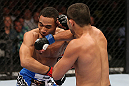 MINNEAPOLIS, MN - OCTOBER 05:  (R-L) Jussier Formiga punches John Dodson during their flyweight fight at the UFC on FX event at Target Center on October 5, 2012 in Minneapolis, Minnesota.  (Photo by Josh Hedges/Zuffa LLC/Zuffa LLC via Getty Images)