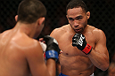 MINNEAPOLIS, MN - OCTOBER 05:  (R-L) John Dodson squares off with Jussier Formiga during their flyweight fight at the UFC on FX event at Target Center on October 5, 2012 in Minneapolis, Minnesota.  (Photo by Josh Hedges/Zuffa LLC/Zuffa LLC via Getty Images)