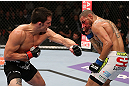 MINNEAPOLIS, MN - OCTOBER 05:  (L-R) Jake Ellenberger punches Jay Hieron during their welterweight fight at the UFC on FX event at Target Center on October 5, 2012 in Minneapolis, Minnesota.  (Photo by Josh Hedges/Zuffa LLC/Zuffa LLC via Getty Images)