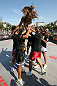 RIO DE JANEIRO, BRAZIL - OCTOBER 10:  Anderson Silva and his team greet a fan after an open training session ahead of UFC 153 at Arcos da Lapa: Praca Cardeal Camara on October 10, 2012 in Rio de Janeiro, Brazil.  (Photo by Josh Hedges/Zuffa LLC/Zuffa LLC via Getty Images)