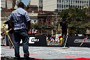 RIO DE JANEIRO, BRAZIL - OCTOBER 10:  Workers spread ice to cool the mats before the UFC 153 open workouts at Arcos da Lapa: Praca Cardeal Camara on October 10, 2012 in Rio de Janeiro, Brazil.  (Photo by Josh Hedges/Zuffa LLC/Zuffa LLC via Getty Images)