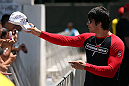 RIO DE JANEIRO, BRAZIL - OCTOBER 10:  Erick Silva greets fans before an open training session ahead of UFC 153 at Arcos da Lapa: Praca Cardeal Camara on October 10, 2012 in Rio de Janeiro, Brazil.  (Photo by Josh Hedges/Zuffa LLC/Zuffa LLC via Getty Images)