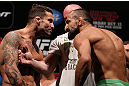 RIO DE JANEIRO, BRAZIL - OCTOBER 12:  (L-R) Opponents Cristiano Marcello and Reza Madadi face off during the UFC 153 weigh in at HSBC Arena on October 12, 2012 in Rio de Janeiro, Brazil.  (Photo by Josh Hedges/Zuffa LLC/Zuffa LLC via Getty Images)