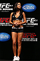 RIO DE JANEIRO, BRAZIL - OCTOBER 12:  UFC Octagon Girl Arianny Celeste stands on stage during the UFC 153 weigh in at HSBC Arena on October 12, 2012 in Rio de Janeiro, Brazil.  (Photo by Josh Hedges/Zuffa LLC/Zuffa LLC via Getty Images)