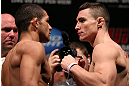 RIO DE JANEIRO, BRAZIL - OCTOBER 12:  (L-R) Opponents Diego Brandao and Joey Gambino face off during the UFC 153 weigh in at HSBC Arena on October 12, 2012 in Rio de Janeiro, Brazil.  (Photo by Josh Hedges/Zuffa LLC/Zuffa LLC via Getty Images)