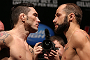 "RIO DE JANEIRO, BRAZIL - OCTOBER 12:  (L-R) Opponents Rony ""Jason"" Mariano Bezerra and Sam Sicilia face off during the UFC 153 weigh in at HSBC Arena on October 12, 2012 in Rio de Janeiro, Brazil.  (Photo by Josh Hedges/Zuffa LLC/Zuffa LLC via Getty Images)"