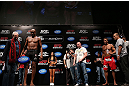 RIO DE JANEIRO, BRAZIL - OCTOBER 12:  Anderson Silva (L) weighs in as opponent Stephan Bonnar (R) looks on during the UFC 153 weigh in at HSBC Arena on October 12, 2012 in Rio de Janeiro, Brazil.  (Photo by Josh Hedges/Zuffa LLC/Zuffa LLC via Getty Images)