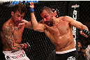 RIO DE JANEIRO, BRAZIL - OCTOBER 13:  (R-L) Reza Madadi punches Cristiano Marcello during their lightweight fight at UFC 153 inside HSBC Arena on October 13, 2012 in Rio de Janeiro, Brazil.  (Photo by Josh Hedges/Zuffa LLC/Zuffa LLC via Getty Images)