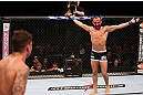 RIO DE JANEIRO, BRAZIL - OCTOBER 13:  (R-L) Reza Madadi taunts Cristiano Marcello during their lightweight fight at UFC 153 inside HSBC Arena on October 13, 2012 in Rio de Janeiro, Brazil.  (Photo by Josh Hedges/Zuffa LLC/Zuffa LLC via Getty Images)