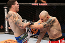 RIO DE JANEIRO, BRAZIL - OCTOBER 13:  (L-R) Chris Camozzi delivers a knee strike against Luiz Cane during their middleweight fight at UFC 153 inside HSBC Arena on October 13, 2012 in Rio de Janeiro, Brazil.  (Photo by Josh Hedges/Zuffa LLC/Zuffa LLC via Getty Images)
