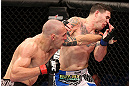 RIO DE JANEIRO, BRAZIL - OCTOBER 13:  (L-R) Luiz Cane punches Chris Camozzi during their middleweight fight at UFC 153 inside HSBC Arena on October 13, 2012 in Rio de Janeiro, Brazil.  (Photo by Josh Hedges/Zuffa LLC/Zuffa LLC via Getty Images)